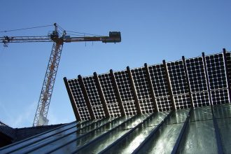Solar roof with construction crane