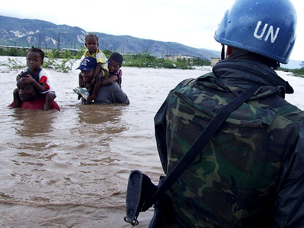 A UN peacekeeper helps hurricane victims in 2008