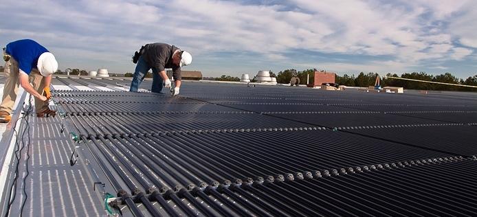 Installation of Solyndra's cylindrical solar module design