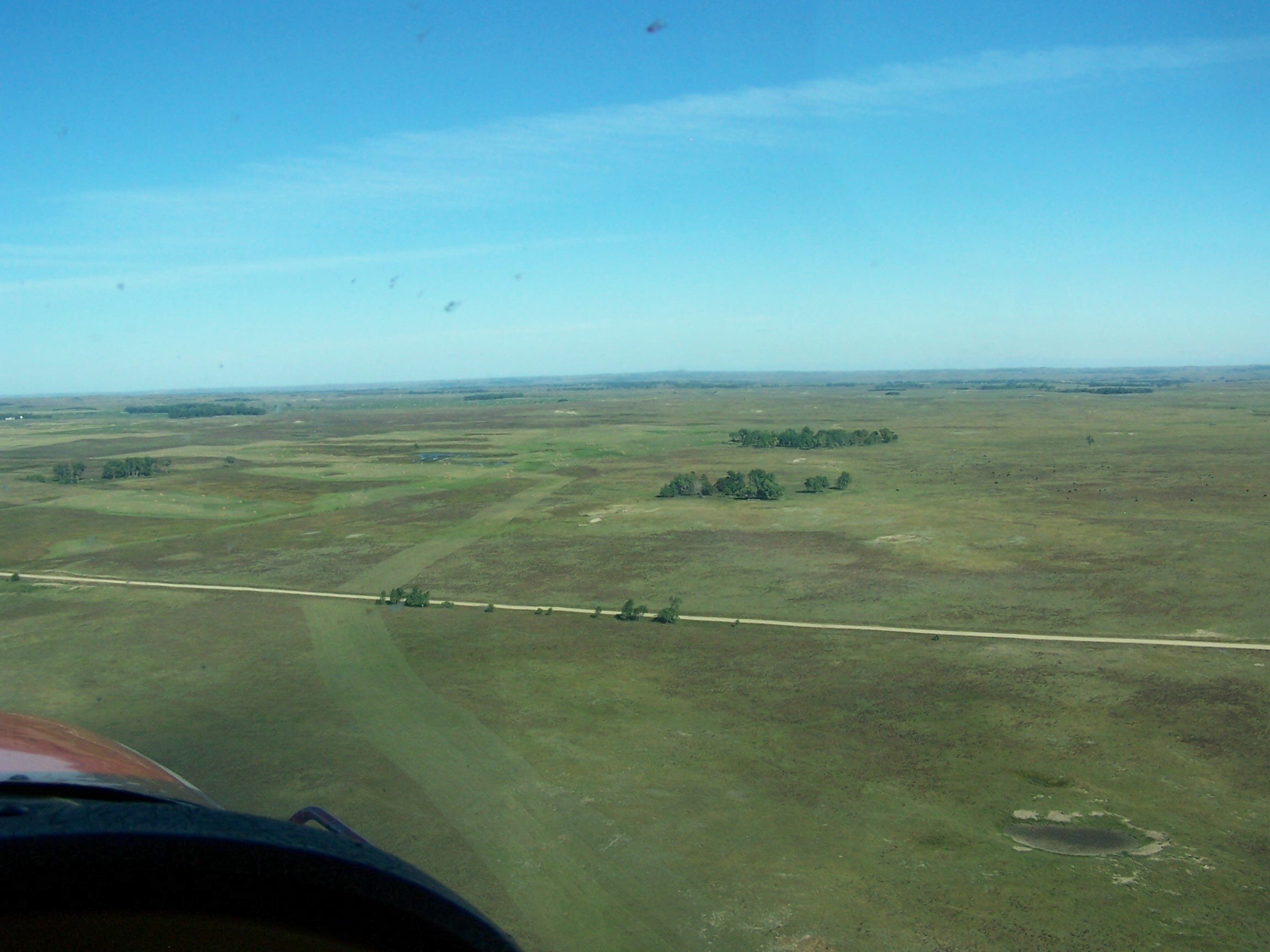 A long strip mowed through the Nebraska sandhills