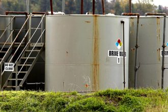 "Tanks labeled as ""Brine Water"" on a property in Dimock, Pa."