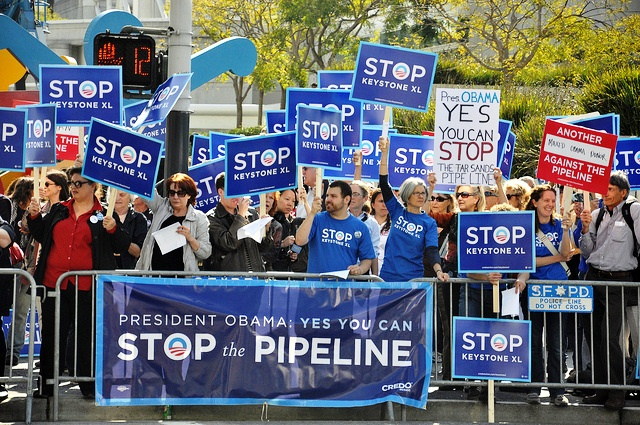 Demonstrators protest against the Keystone XL pipeline outside an Obama fundrais
