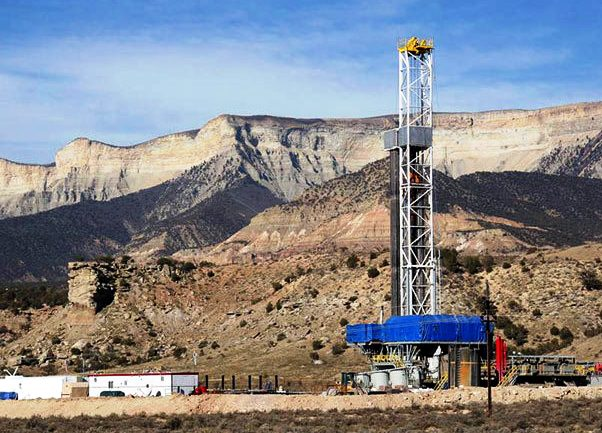 A drilling rig stands over a natural gas well in Colorado