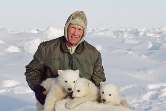 Steve Amstrup, the 2012 Indianapolis Prize winner, with polar bear cubs.