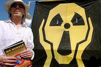 Protester rallies outside the idled San Onofre nuclear plant earlier this year.