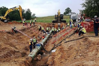 Crews replace the ruptured section of the Line 14 pipeline near Grand Marsh, Wis