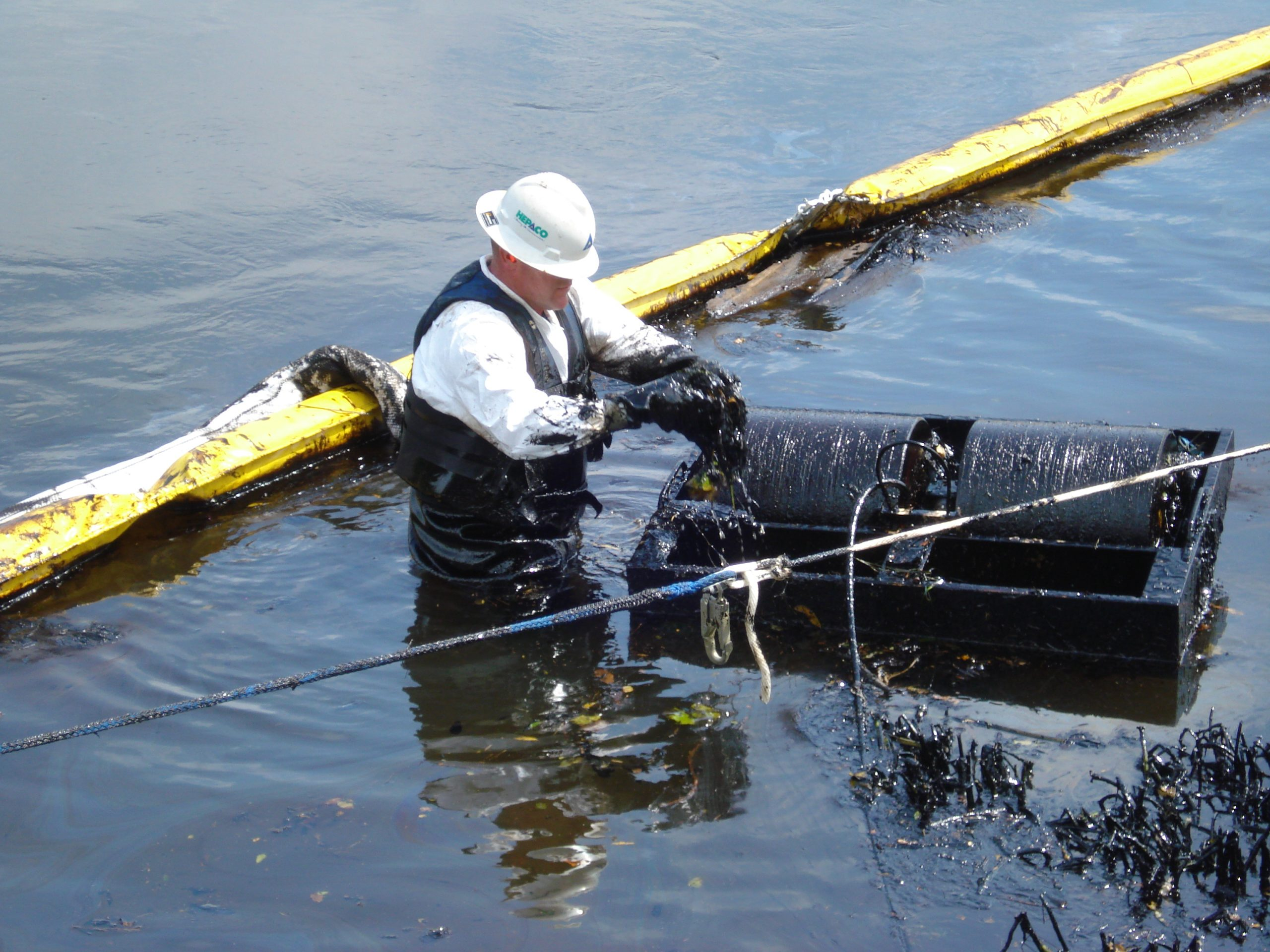 Worker cleaning up the Kalamazoo River on Aug. 4, 2012.