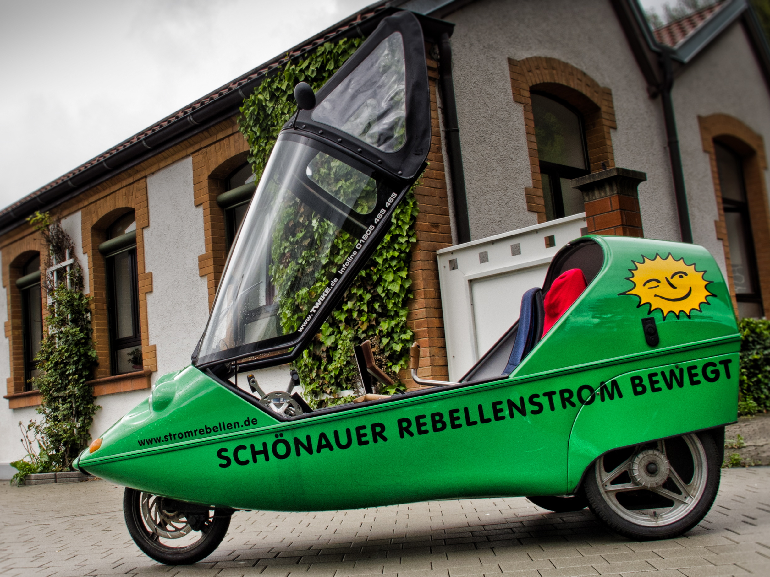 Electric car outside of EWS, Germany's first green power cooperative utility.