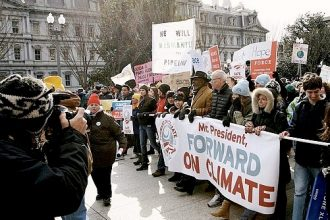 Protesters march to the White House and urge Pres. Obama to reject the Keystone