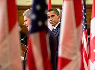 President Barack Obama and Prime Minister Stephen Harper at a press conference i