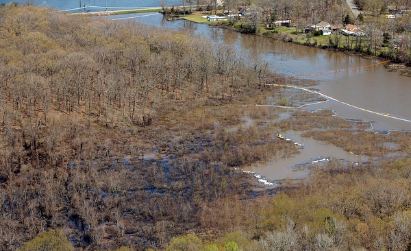 Crude oil from an Exxon pipeline that ruptured a mile away in an Arkansas suburb