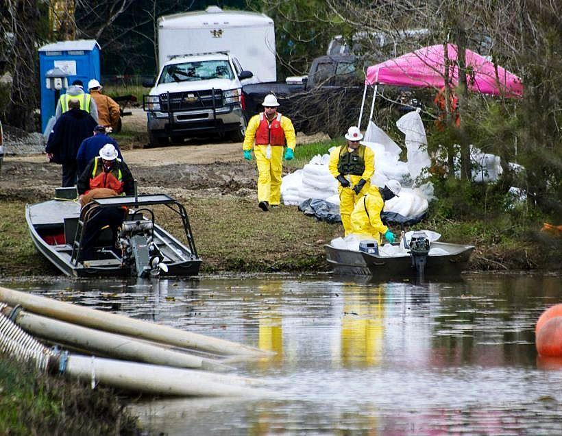 Workers clean up oil following ExxonMobil's Pegasus pipeline rupture