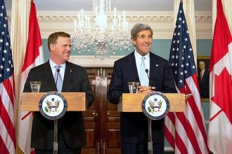 John Kerry holds a joint press conference with John Baird