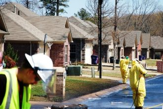 Clean-up workers at the site of Exxon's pipeline spill
