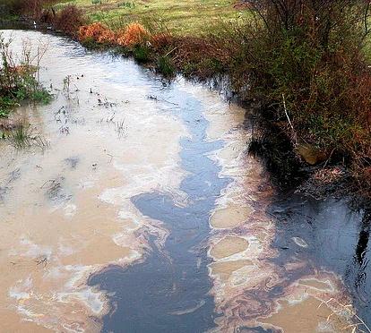 Spilled oil in a creek in Mayflower, Ark.