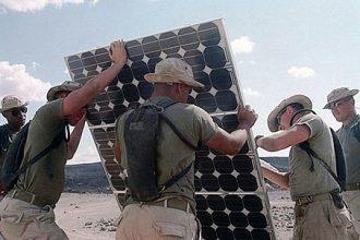 Marines build a solar panel.