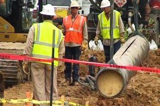 Officials assess the break in ExxonMobil's 838-mile Pegasus pipeline