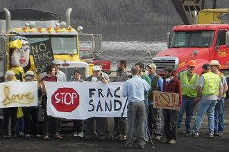 Demonstrators protest against the frac sand industry in Winona on April 29, 2013
