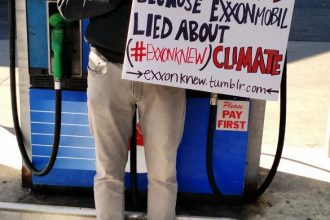 Bill McKibben protested Exxon's climate denial at a Burlington, Vt. gas station