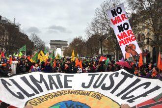 Activists at Paris climate talks