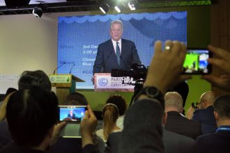 Al Gore spoke at a Paris event urging the economic transition to clean energy