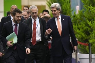 Chief U.S. climate negotiator Todd Stern, center, with Secretary of State John Kerry, right, and White House advisor Brian Deese