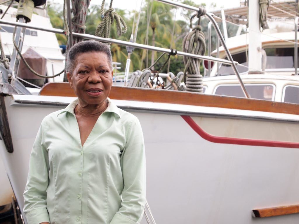 Audrey Peterman stands next to her boat