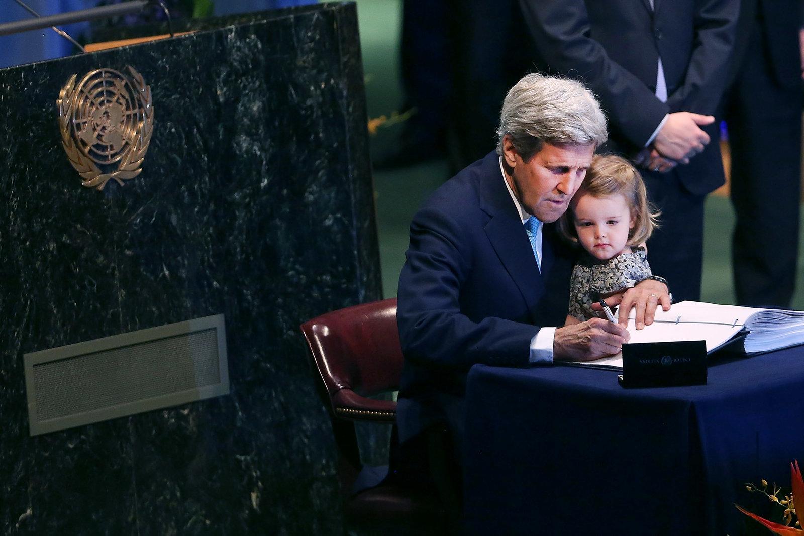 U.S. Secretary of State John Kerry signs the international climate accord