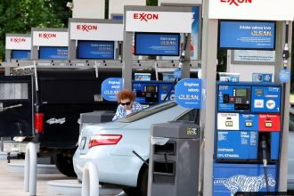 Exxon's shareholders meeting comes up this week with new attention to climate risks.