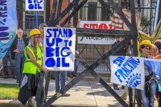 Anti-fracking protesters outside Colorado Gov. John Hickenlooper's house