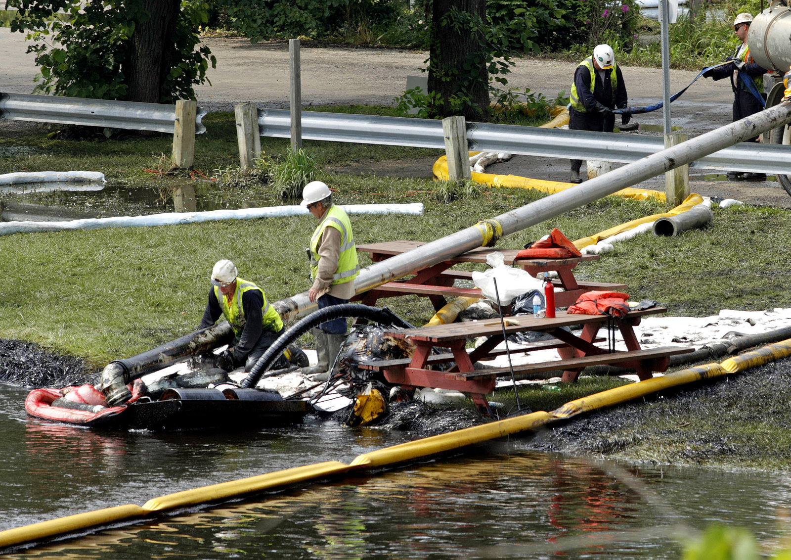 Workers try to clean up the 2010 Kalamazoo River spill after the Enbridge pipeline leak.