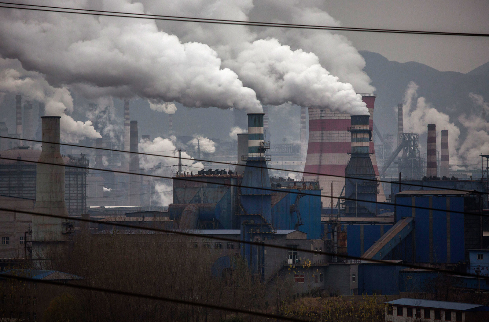 A coal-fired generator powers a steel plant in China