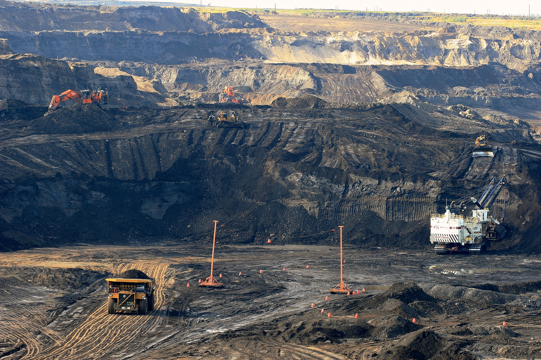 Canada's reliance on fossil fuels, particularly from the oil sands, is questioned by a government report