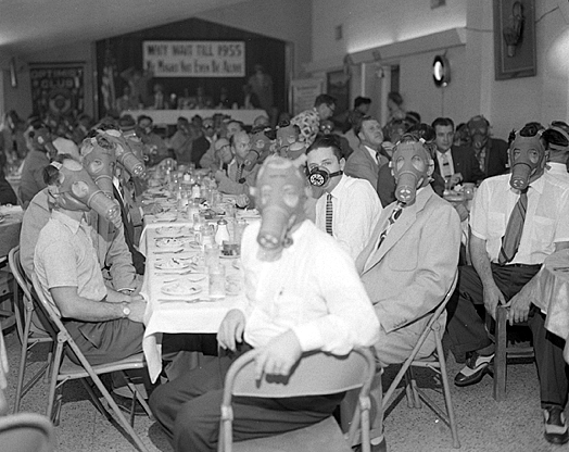 Members of the Highland Park Optimist Club in Northeast L.A. are seen here wearing smog-gas masks