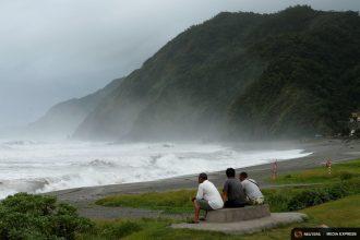 Men watch the ocean as super typhoon Nepartak nears the coast of Taiwan