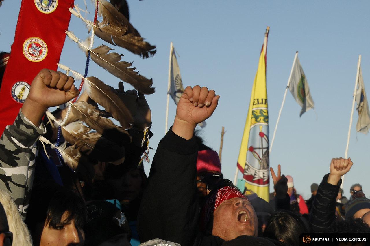 Dakota Access protesters celebrate Sunday's decision halting the pipeline