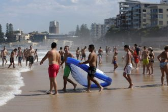 Australians have flocked to the beaches outside Sydney to escape the withering heat