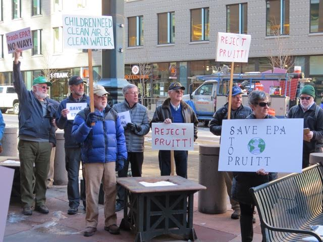 Former EPA employees protest outside Colo. Sen. Michael Bennet's office