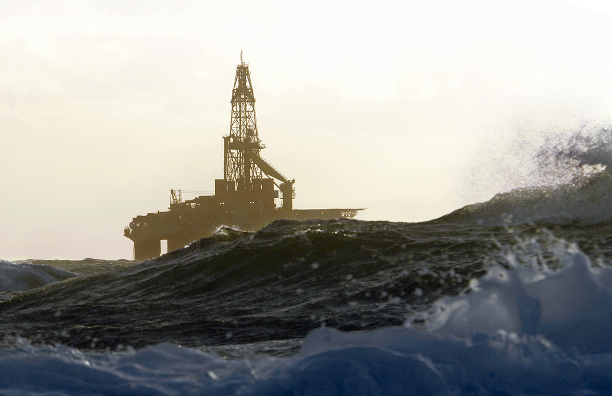 An oil rig during a storm. Photo by Marcel Mochet/AFP/Getty