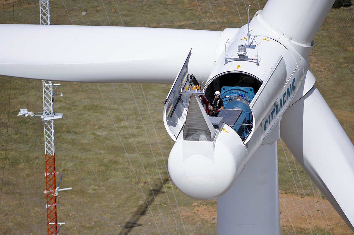 Worker on a wind energy turbine at  the National Wind Technology Center at National Renewable Energy Laboratory