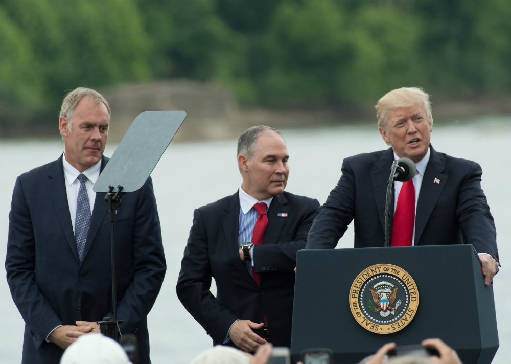 Donald Trump, Scott Pruitt and Ryan Zinke. Credit: Nicholas Kamm/AFP/Getty