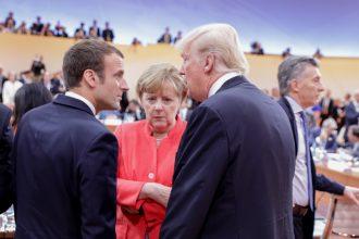 Emmanuel Macron of France and Angela Merkel of Germany talk with Donald Trump.