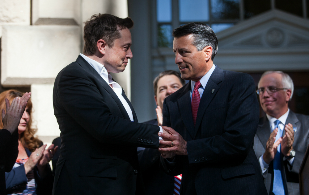 Nevada Gov. Brian Sandoval with Tesla CEO Elon Musk. Credit: Max Whittaker/Getty Images