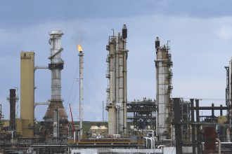 An increase in carbon-intensive fuels like tar sands accelerated greenhouse gas emissions.