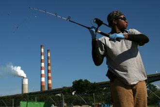 Fishing on the Potomac, overshadowed by a power plant. Credit: Mark Wilson/Getty Images