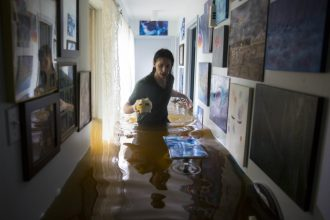 Walking through a flooded home in Houston. Credit: Erich Schlegel/Getty