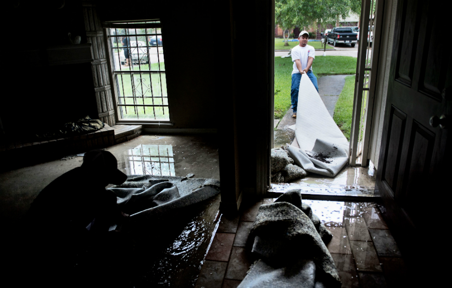 When flood water gets into a home, it soaks carpets and walls, where it can fuel the growth of potentially dangerous mold. Credit: Brendan Smialowski/AFP/Getty Images