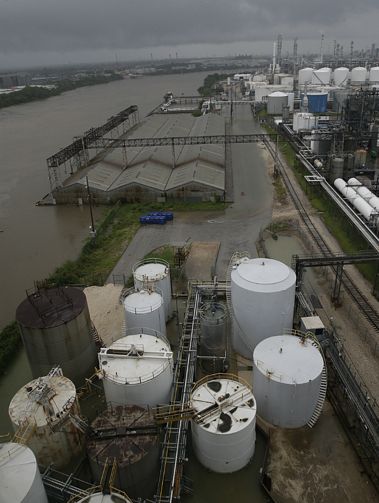 Water in the Houston Ship Channel rises beside the refineries rainfall from Harvey inundates the region. Credit: Thomas B. Shea/AFP/Getty Images