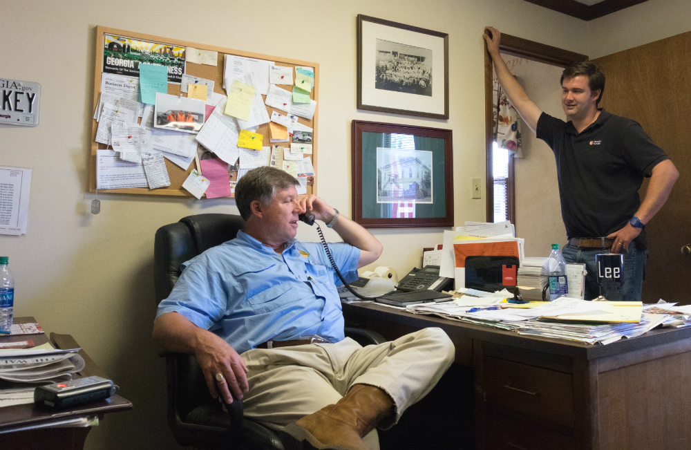 Robert Dickey and his son Lee share an office on their Georgia farm, where their family has been growing peaches for 120 years. Credit: Meera Subramanian