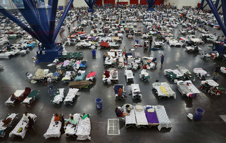 Thousands of people took shelter at the George R. Brown Convention Center in Houston as their homes flooded during Harvey. Credit: Joe Raedle/Getty Images